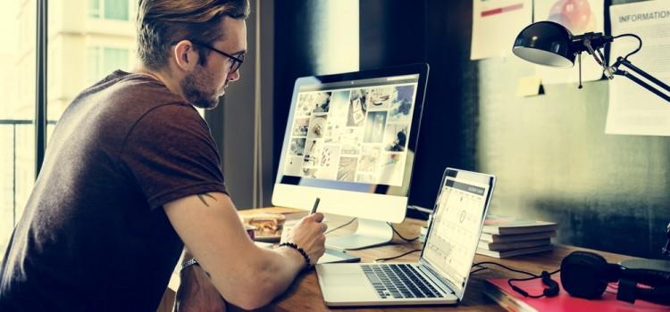 man editing footage on multiple monitors